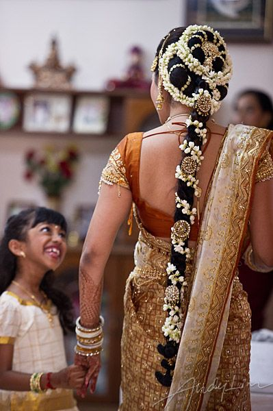 Name:  South-indian-bridal-jewellery-long-hair-flowers-and-jewelery-beautiful-smile.jpg Views: 127 Size:  51.3 KB